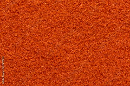 Fotografering  Chili paprika powder ground full frame smooth surface