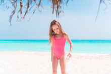 Portrait Of Adorable Little Girl At Beach On Her Summer Vacation