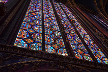 Interior And Stained Glass Windows Of The Magnificent Gothic Chapel Of Sainte Chappelle In Paris