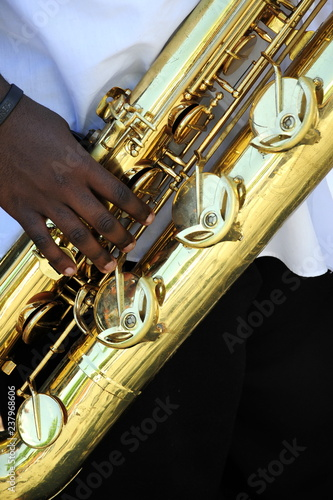 African american male jazz baritone saxophone musician performing outdoors Canvas Print