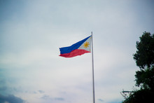 A Flag Of Philippines. Philippines Is A Country Located In The South East Asia. Their Climate Is Mostly Tropical.