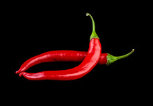 Red Chilli Peppers On Black Background