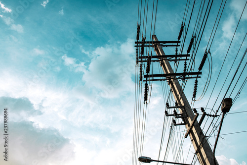 Fotografia Electricity pole against blue sky clouds, Transmission line of electricity to ru