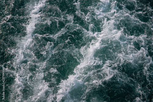 Canvas Prints Marble Ocean water texture with white foamy wave. Tropical island hopping or marine travel banner.