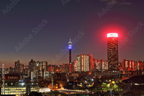 Fototapeta premium JOHANNESBURG, SOUTH AFRICA - June 17, 2017: Sunset view of the Johannesburg city skyline including the Ponte and Hillbrow Towers.