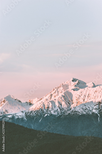 Foto op Aluminium Groen blauw Snowy mountains peaks range landscape travel aerial view wilderness nature tranquil evening winter sunset scenery
