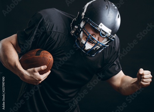 American Football Sportsman Player In Black Outfit And