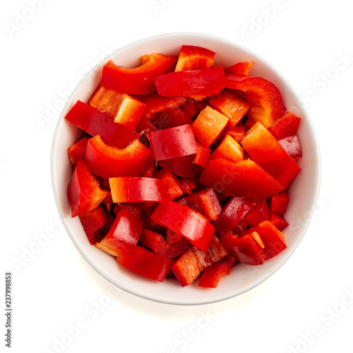 Tablou Canvas Chopped red pepper in bowl isolated on white background. Top view