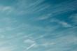 canvas print picture - Cirrus clouds in a bright blue sky in autumn.