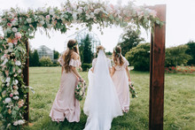 Bridesmaids In Pink Dresses Wi...