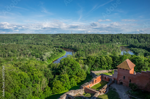 фотография  Turaida castle in Latvia, a top view, in the distance the river and forest