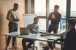 Multiethnic business men dressed in casual trendy wear debating vivaciously during working meeting in conference room, panoramic view