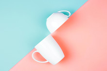 Two White Cups On Color Background. Abstract, Top View. Living Coral And Limpet Shell. Trendy Colors Of The 2019.