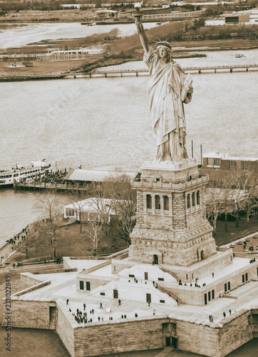 In de dag New York City Overhead aerial view of Statue of Liberty from helicopter, New York City in winter