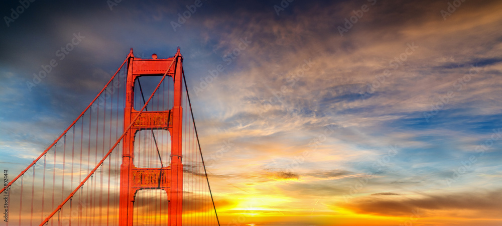 Colorful sky over world famous Golden Gate bridge in San Francisco at sunset