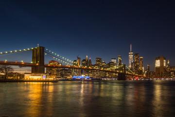 Fototapeta na wymiar Manhatan and Brooklyn Bridge at Night. New York City, United States of America