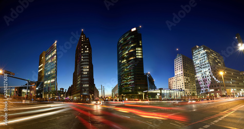 Spoed Foto op Canvas Stad gebouw Berlin, Germany night view while sundown on the modern illuminated highrise buildings and traffic at the Potsdamer Platz in the Berlin city centre