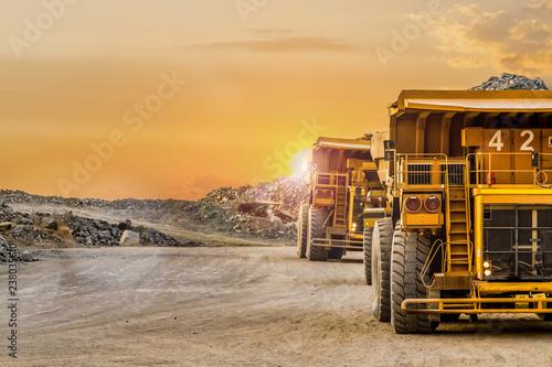 Pinturas sobre lienzo  Mining dump trucks transporting Platinum ore for processing
