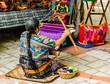 Leinwanddruck Bild - Woman weaving in an old village in Guatemala.  Traditional waver from Guatemala.