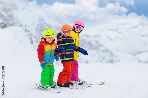 obraz PCV Ski and snow winter fun for kids. Children skiing.