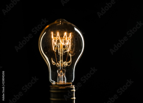 Fotografija Edison's light bulb illuminates from electric current