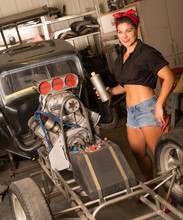 Woman Ready To Squirt Fuel Into The Engine To Start