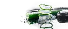 Aloe Vera Sliced Leaf And Spa Stones Closeup On White Background, Natural Organic Renewal Cosmetics, Alternative Medicine. Skincare Concept