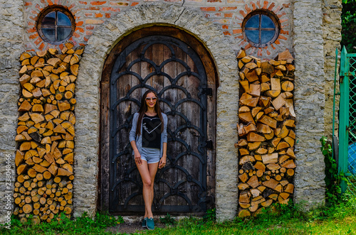 young woman near stained glass window and wood wall © BohdanM