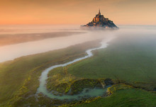 Aerial View To Castle Mont Saint-Michel In Orange Sunset In France