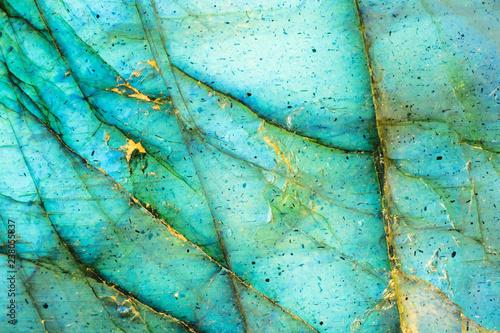 Valokuvatapetti Macro photo of an illuminated aqua blue moonstone.