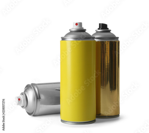 Cans of different spray paints on white background Canvas Print