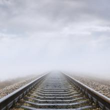 Railroad In Fog To Horizon In Clouds