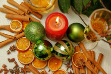 Holiday Christmas Decoration With White Wine, Christmas Ball, Candle, Dried Orange, Anise Stars And Sticks Of Cinnamon. Wooden Table And Vintage Background.