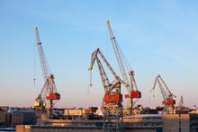 Construction Cranes Work In The Port Of Helsinki In Winter