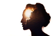 Multiple Exposure Portrait Of A Woman. The Sun Behind The Clouds. Emotional Intelligence Concept.