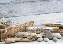 Nautical Still Life With Old I Love You Message In A Bottle, Stone Heart And Driftwood