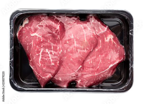 Vacuum-packed beef on a white background. Marbled beef from the store isolated on a white background. - 238079220