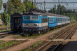 Blue electric train in Cicenice station in spring sunny day