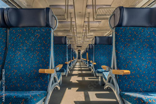 Interior of blue train with blue seat and wooden armrest Canvas Print