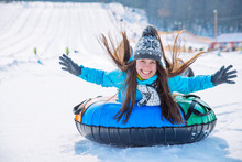 Young Smiling Girl Ride Sleigh Snow Tubing Hill Winter Activity
