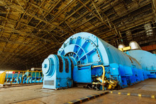 Interior Of Turbine Generator In A Big Power Plant. Hydroelectric Power Plant.