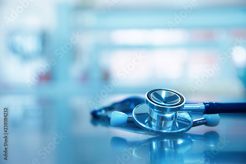 stethoscope for medical doctor diagnosis on blue health science laboratory background