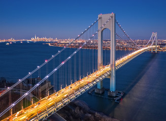 Fototapeta Mosty Aerial view of the evening rush hour traffic on Verrazzano Narrows Bridge, as viewed from Staten Island, NY