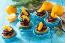 Orange Cupcakes With Chocolate Cream And Fresh Tangerines.