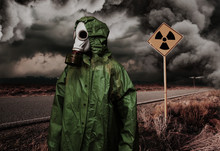Man In Gas Mask With Radiation Area Caution Sing. Nature Protection Concept