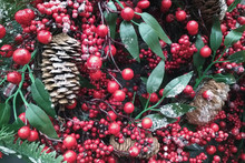 Christmas Colorful Decoration Closeup Image. Tree Pine Cones, Apples, Red Berries And Cinnamon Sticks In Spruce Branches