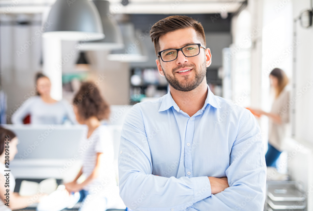 Fototapeta New start up business concept. Portrait of young confident man.