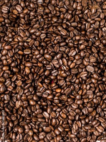 Deurstickers koffiebar Brown roasted coffee beans, seed on dark background. Espresso dark, aroma, black caffeine drink. Closeup isolated energy mocha, cappuccino ingredient.