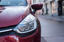 Mulhouse - France - 9 December 2018 - Closeup Of  Front Light Red Renault Clio  Parked In The Street