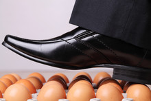 Man Walking On Eggs.  An Expression Which Means You Are In A Difficult Position And Must Be Very Careful